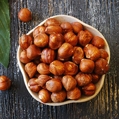 Hazelnuts (Filberts) Hazelnuts or filberts have a full, rich distinctive, slightly woody flavor. This is an excellent nut to add to mixed nut snacks or trail mixes because of the unique taste. 8 oz Bag  $10.99