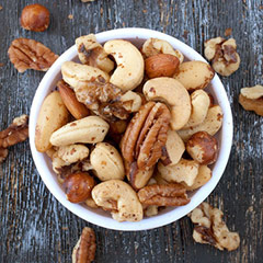 Roasted Unsalted Deluxe Mixed Nuts <p>This fancy combination of Deluxe Mixed Nuts include only the finest and freshest large cashews, pecans, almonds, filberts, walnuts, and macadamias. Perfect to eat on-the-go!<br /></p><br /><p></p> 8 oz Bag  $13.99