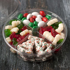 "Christmas Collection Tray <p>A wonderful collection of holiday treats for guests, as a gift or for yourself! 14.3 oz of the most popular ""must have"" holiday treats. </p><p>• Christmas Tree Gummies<br /></p><p>• Christmas Gummy Bears </p><p>• Christmas Chocolate Almonds</p><p>• Yogurt Covered Pretzels</p> 14 oz Tray  $14.99"